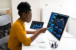African American Business Data Analyst Woman Using Computer.jpg