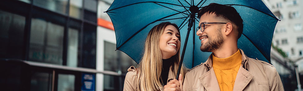 Smiling man and woman who have experienced successful results with Transcranial Magnetic Stimulation at St. John Mental Health Clinic of Houston.