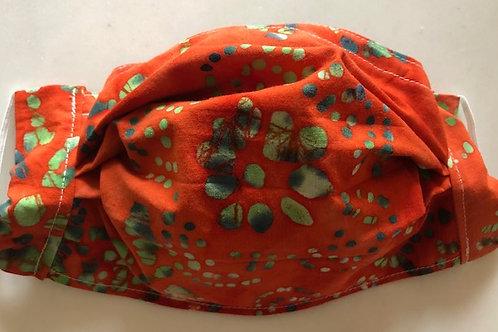 Bright orange batik with mint green pattern