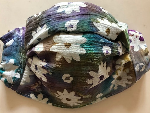 Floral batik in blue/purple/green tones with white flowers