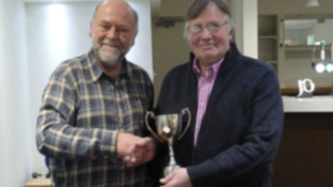 Phil Haste receiving the Ian Hannaford cup for Chairman Julian Smith.