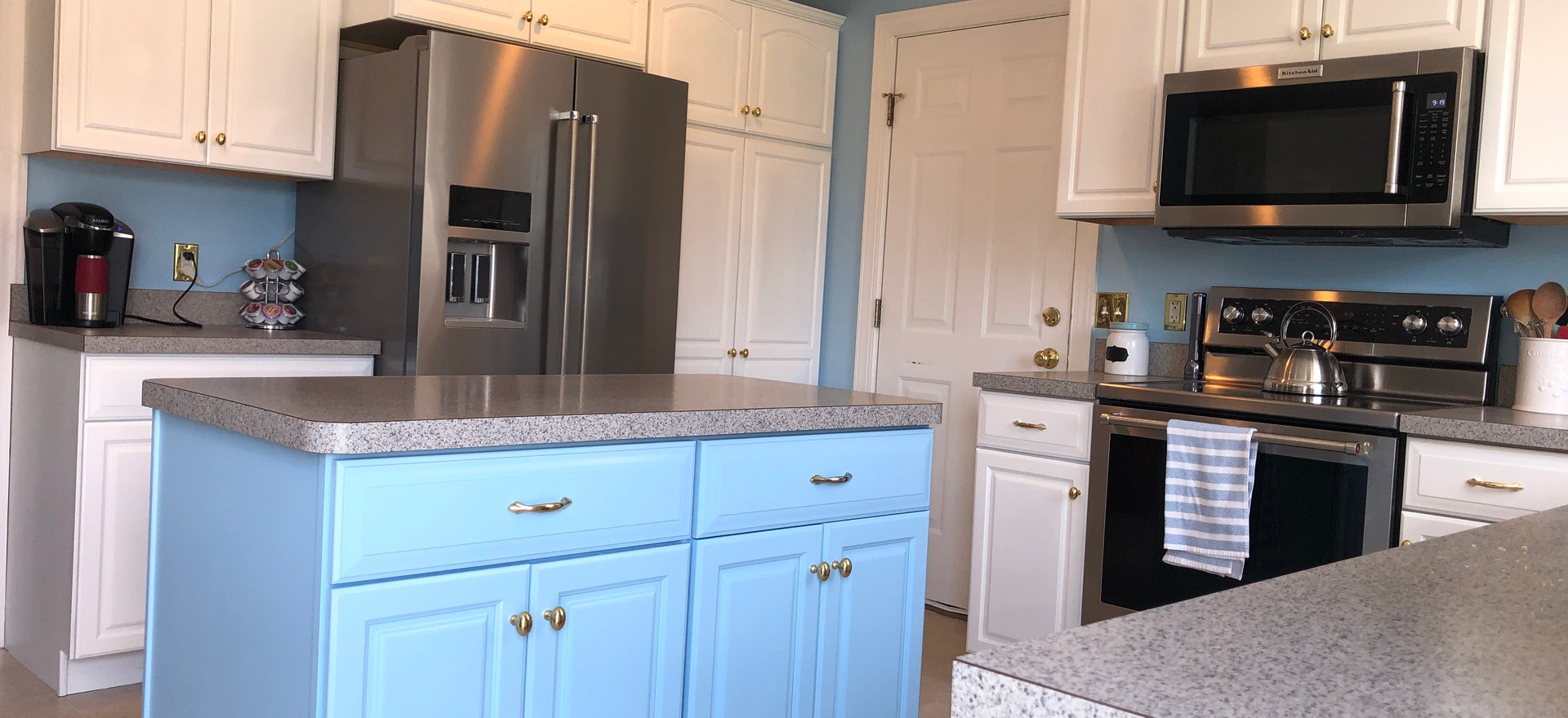 White Kitchen with Accent Blue Island to match walls