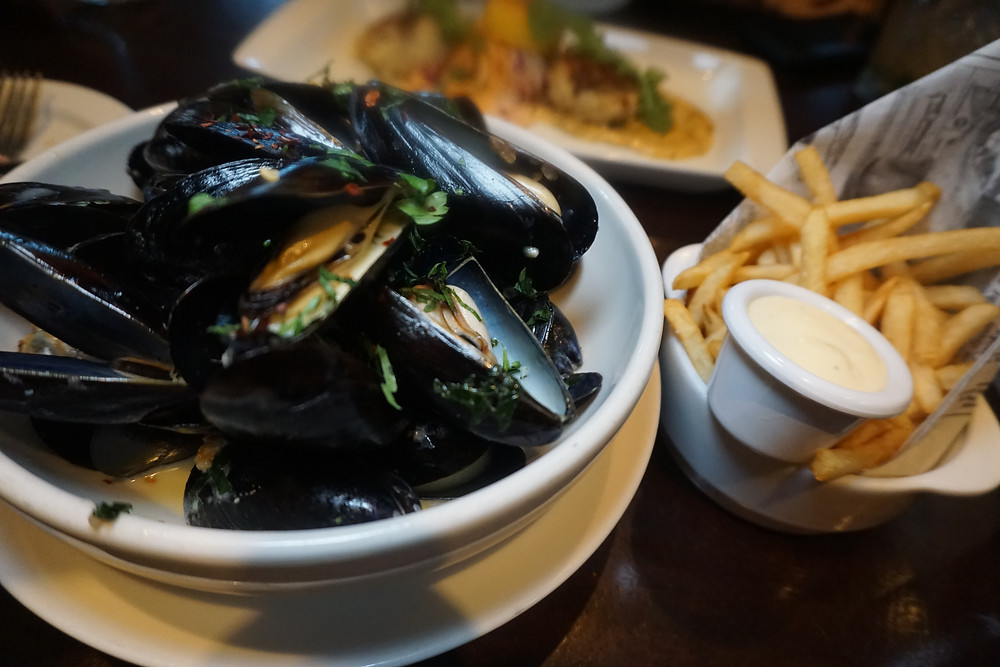 P.E.I. mussels steamed with white wine, parsley butter and fried garlic, topped with french fries