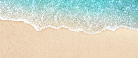 Soft blue ocean wave on clean sandy beach_edited.jpg