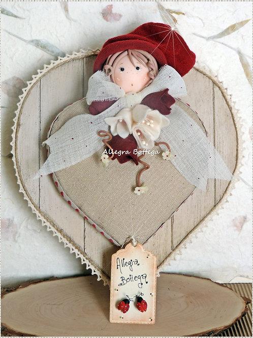 Perla, bambola sul cuore