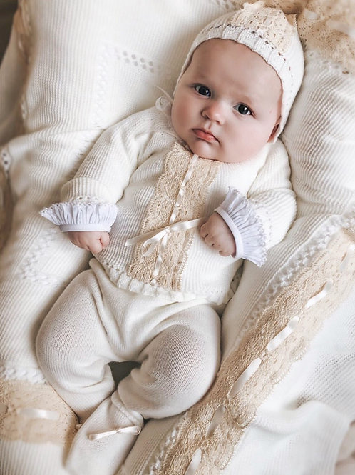 Otis Foster wearing 'Bambi' in chic cream and matching 'Lucella Lace' blanket
