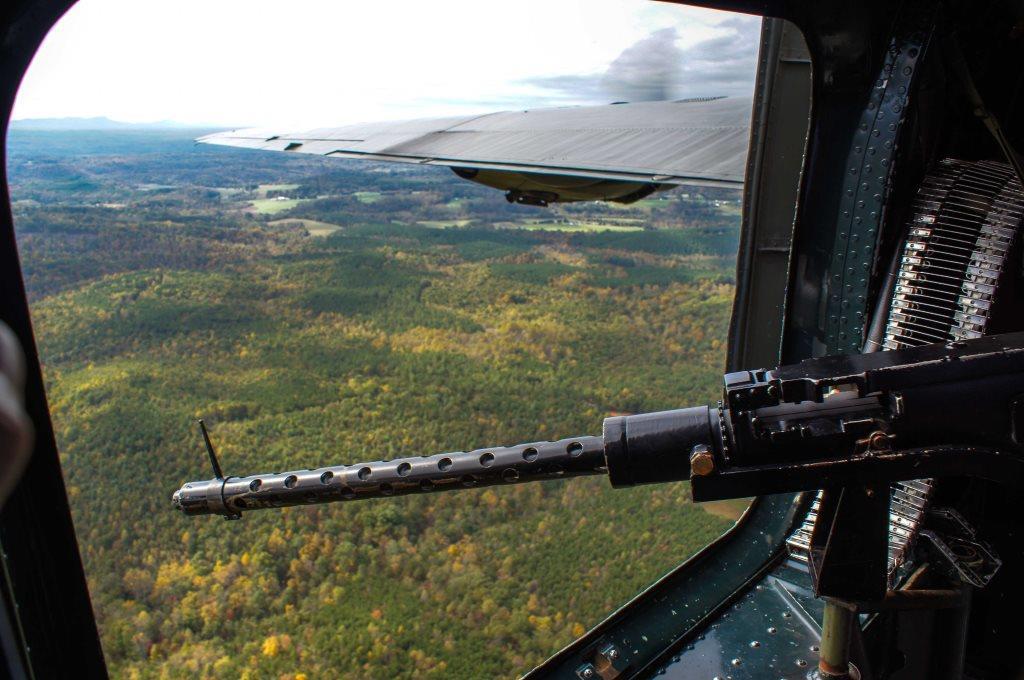 B-24 waist gun in flight
