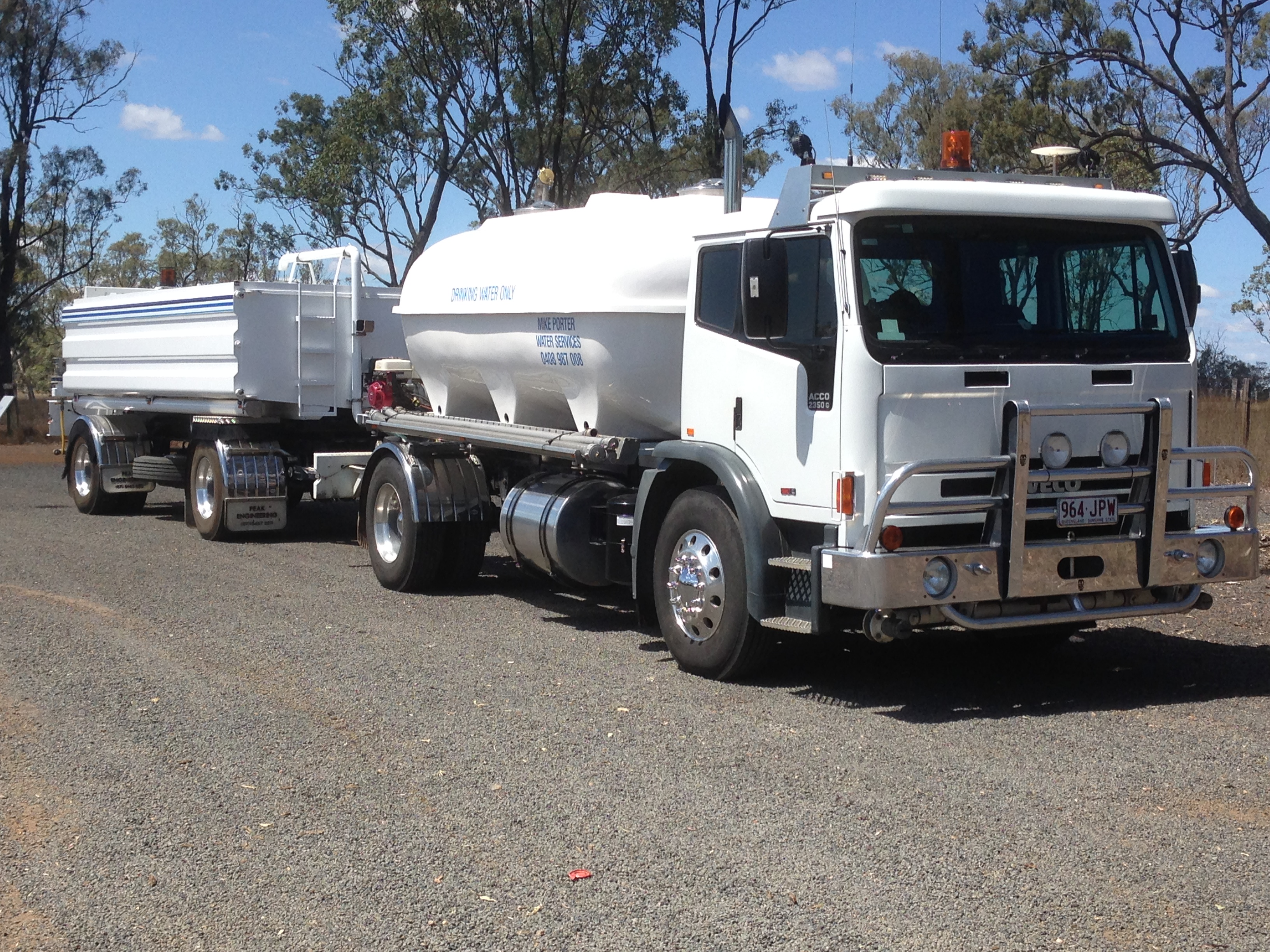 Water truck and dog tanker trailer