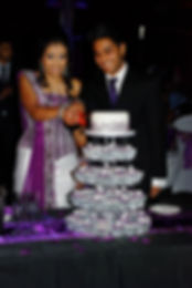 Beautifully Crafted Purple Henna Wedding Cake and Cupcake Tower by Cakes by Joti