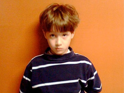 Boy wearing a striped shirt
