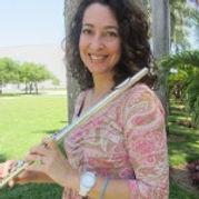 Elissa Lakofsky, Flute/Piccolo player holding a flute