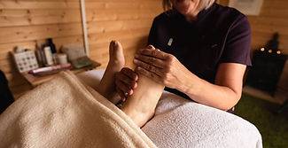 Rachel Webb is giving reflexology