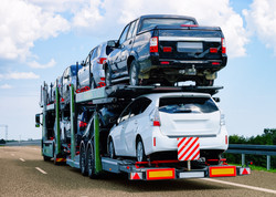 Cars carrier at the road of Poland