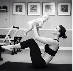Rebecca Pilates with Baby_edited.png