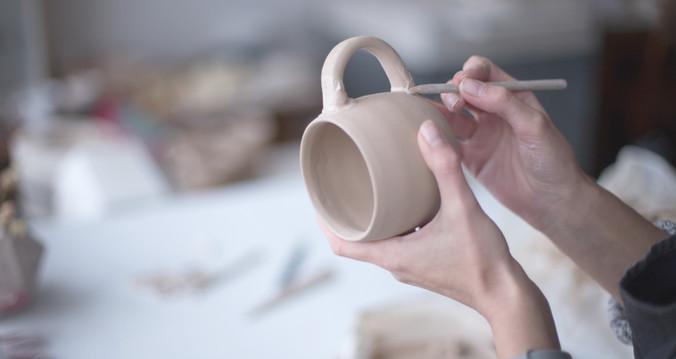 female-potter-making-mug