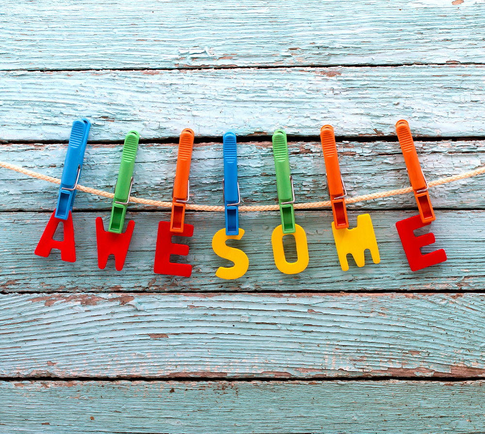 letters spelling the word awesome hanging from a clothesline