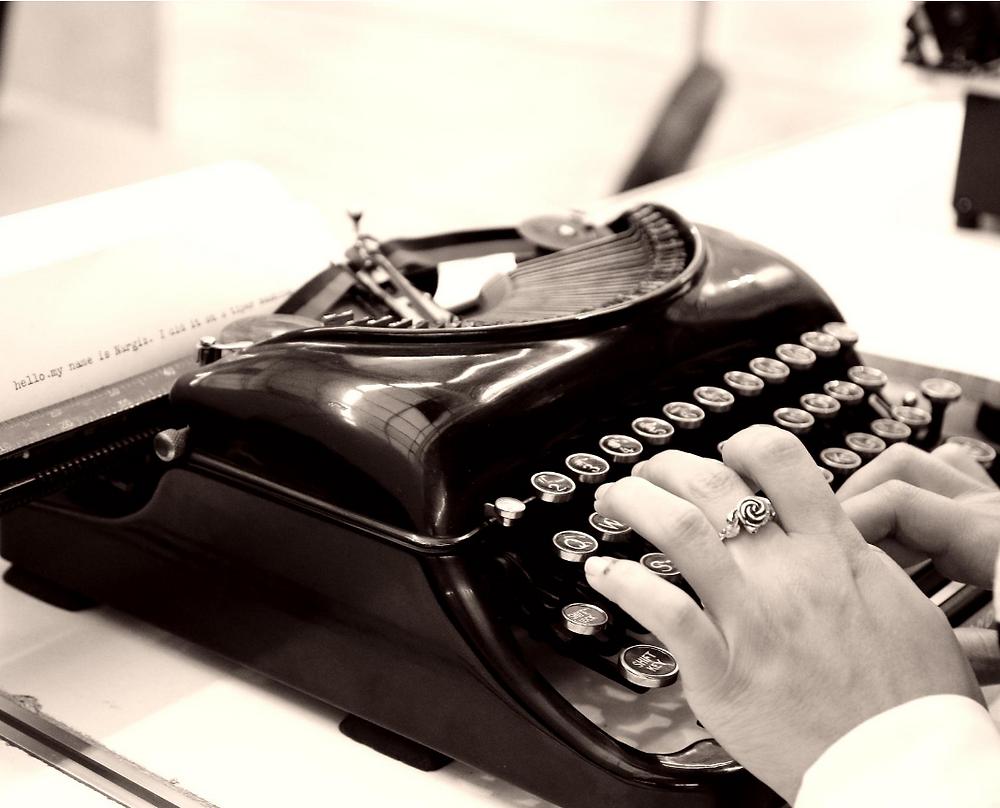 typing on an antique typewriter