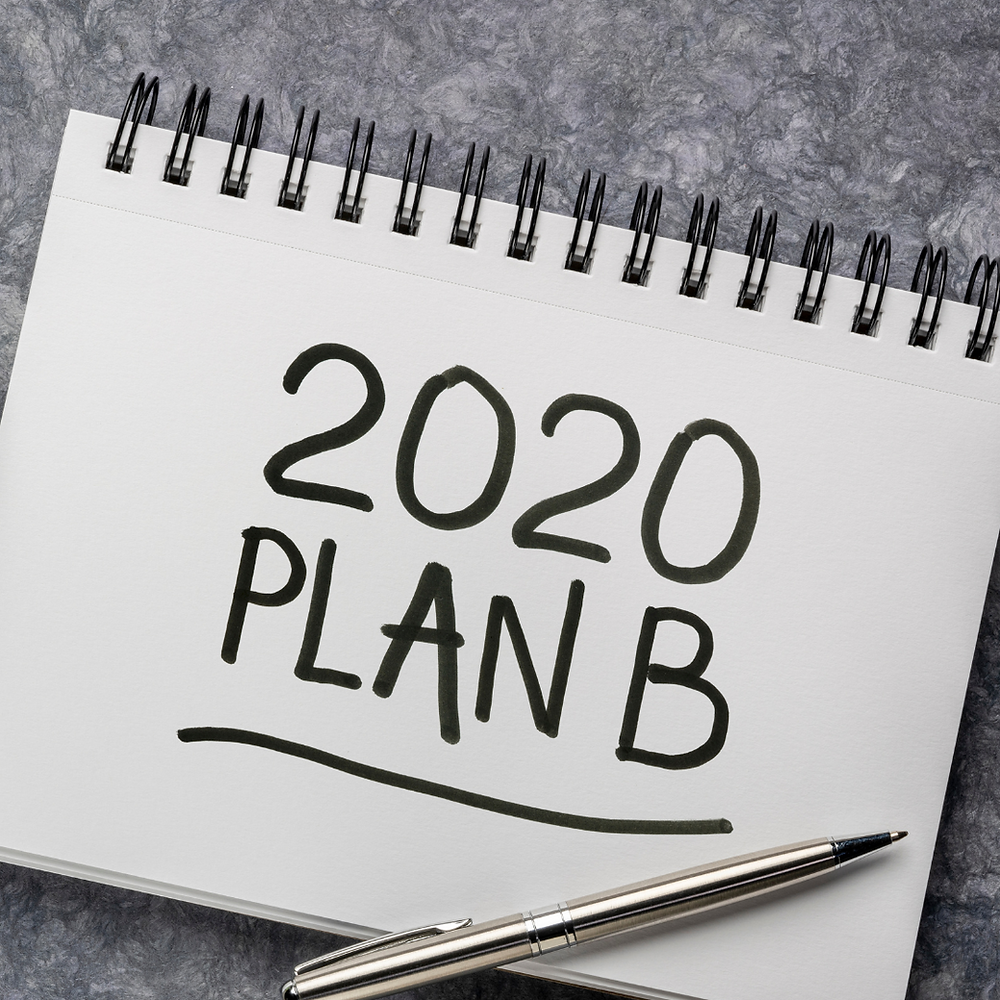 a small notebook with 2020 plan B written on it