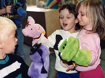 Young children with Kid's Club puppets