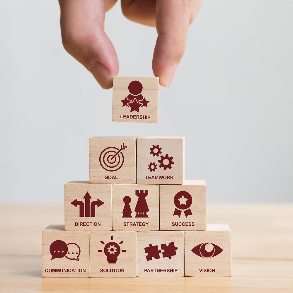 A block tower illustrating characteristics of leadership