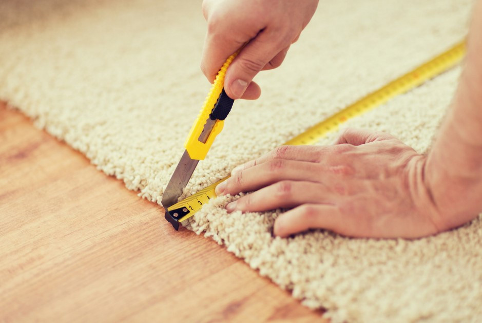 measuring carefully before cutting a carpet