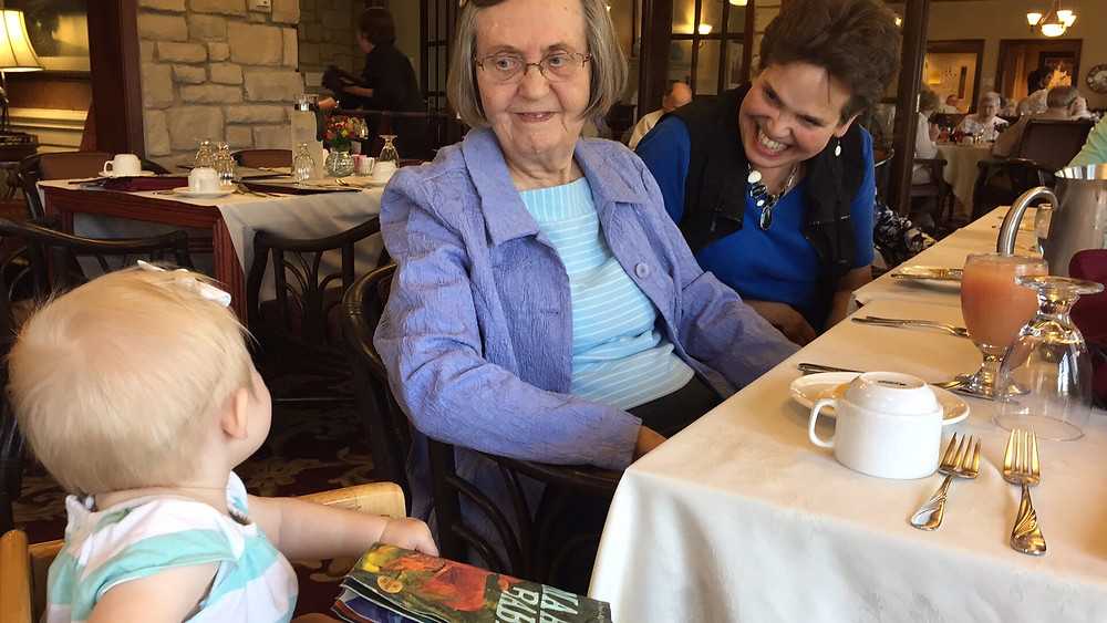 three generations enjoy a family meal together