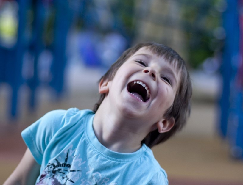 child laughing with exuberance