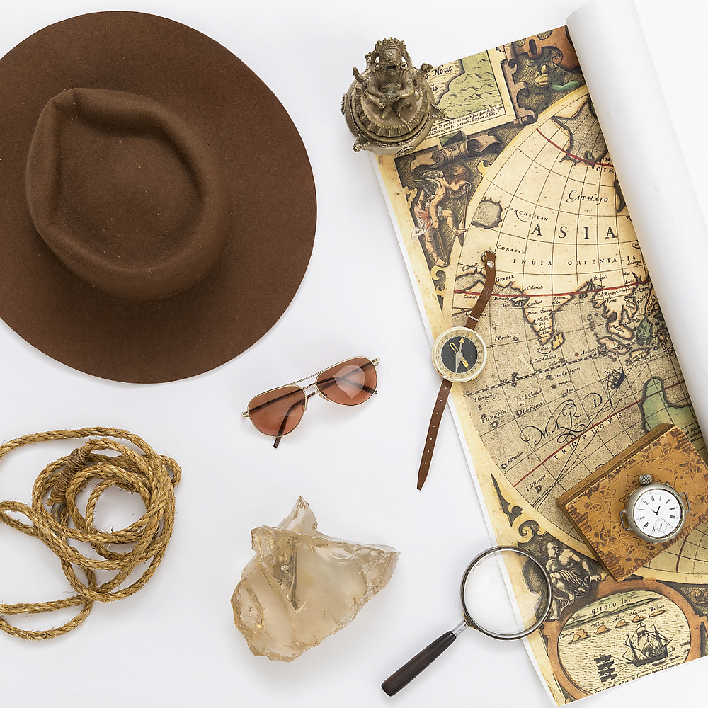 items used when taking a journey including a map and compass