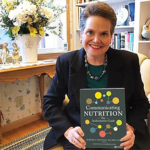 Barb Mayfield holding Communicating Nutriton book