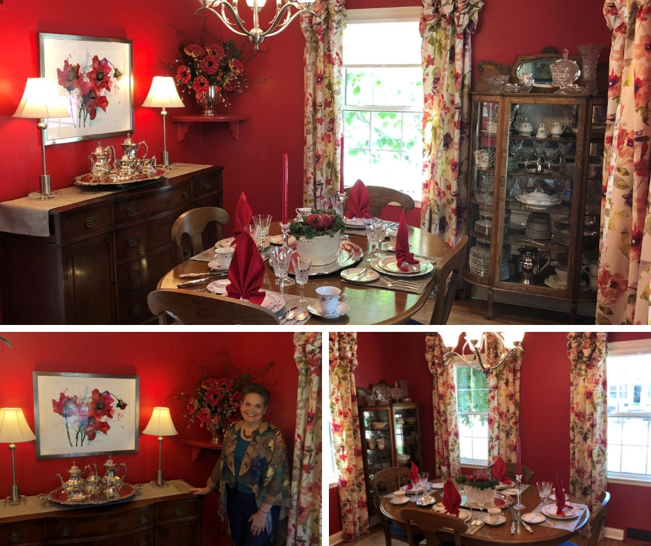 a newly decorated red dining room set for a formal dinner