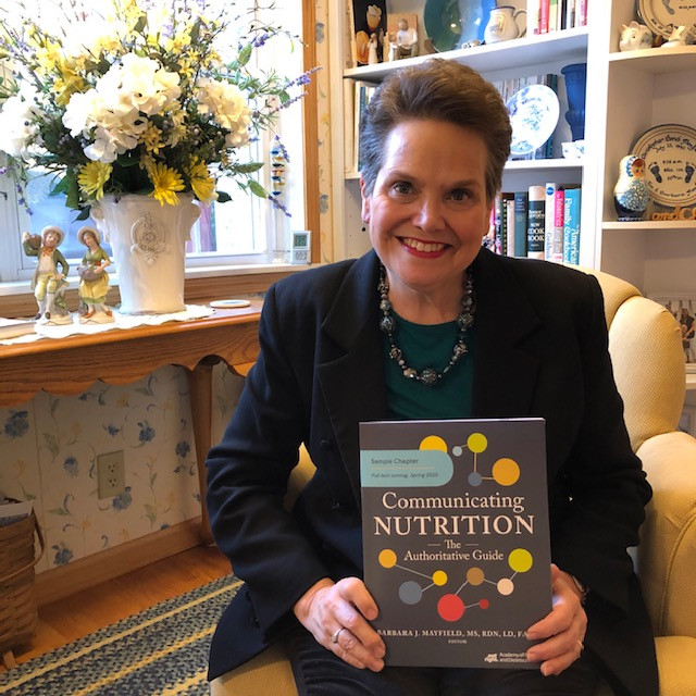Barb Mayfield holds Communicating Nutrition