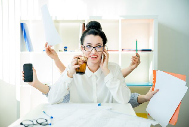 female professional multi-tasking at work