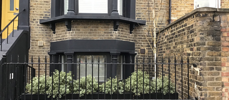 Creating privacy and storage in an E5 Basement Front Garden
