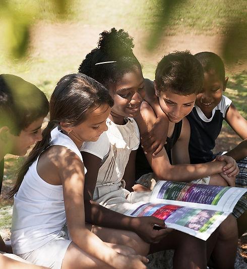 Kids Reading Book in Park.jpg