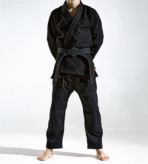 Confident guy in black kimono fighter po