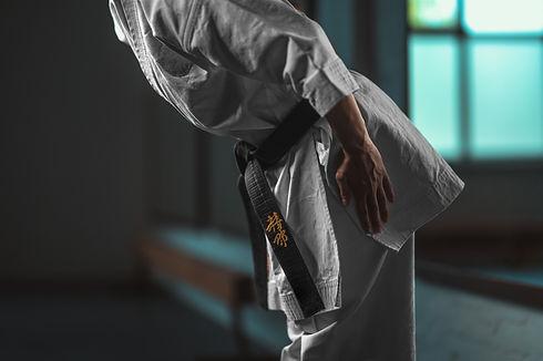 Close Up Karate girl with black belt dis