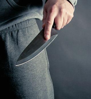 Thug thrusting a knife.jpg
