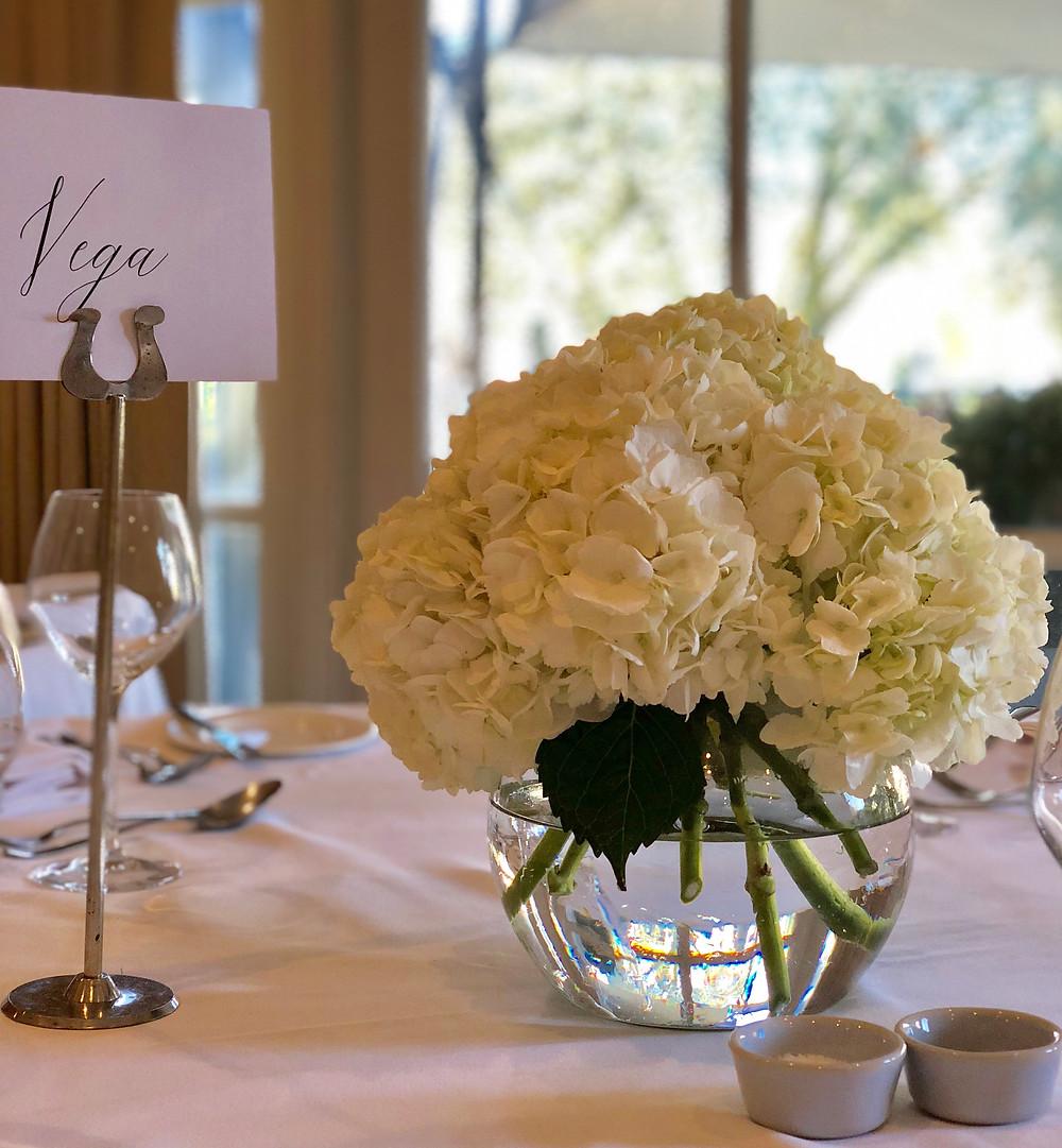 Reception table flowers, vase of Hydrangea blooms Bingham Hotel