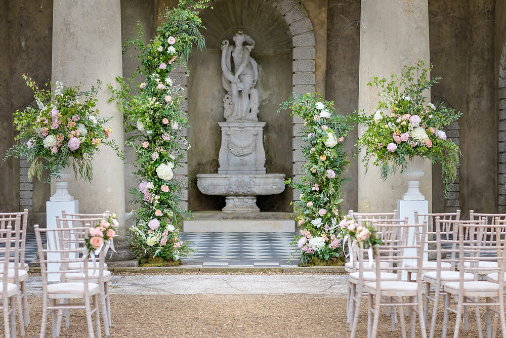 Assymetrical Arch and Pedestal Urn Ceremony Flowers Wotton House