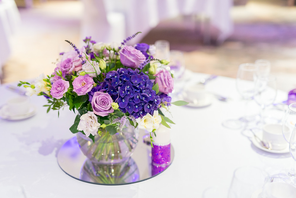 Reception flower filled vases for the Reception tables