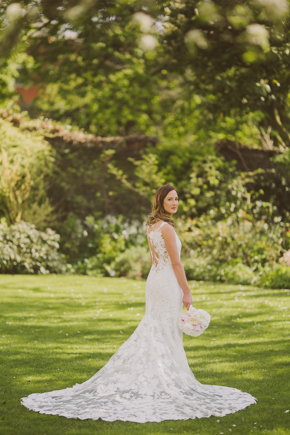 Laura wearing a stunning Pronovias Dress in the Bigham Hotel gardens, photo by @nickrayphoto