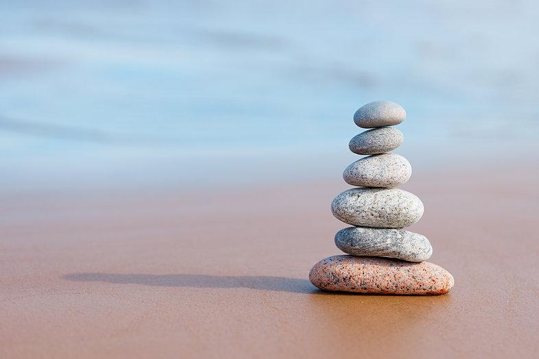 Pyramid stones balance on the sand of th