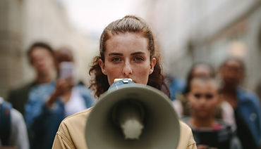 Female activist protesting with megaphon