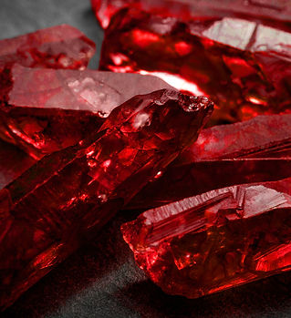 Rubies and raw crystal gems concept with