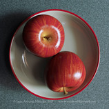 Two apples, almost identical (actually, one of them is a bit bigger than the other)