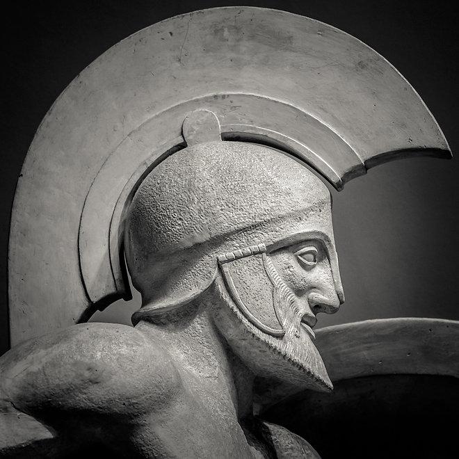 Man in helmet Greek ancient sculpture of