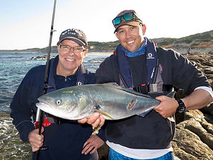 Guide Robbie holding Mark's 1st ever Sal