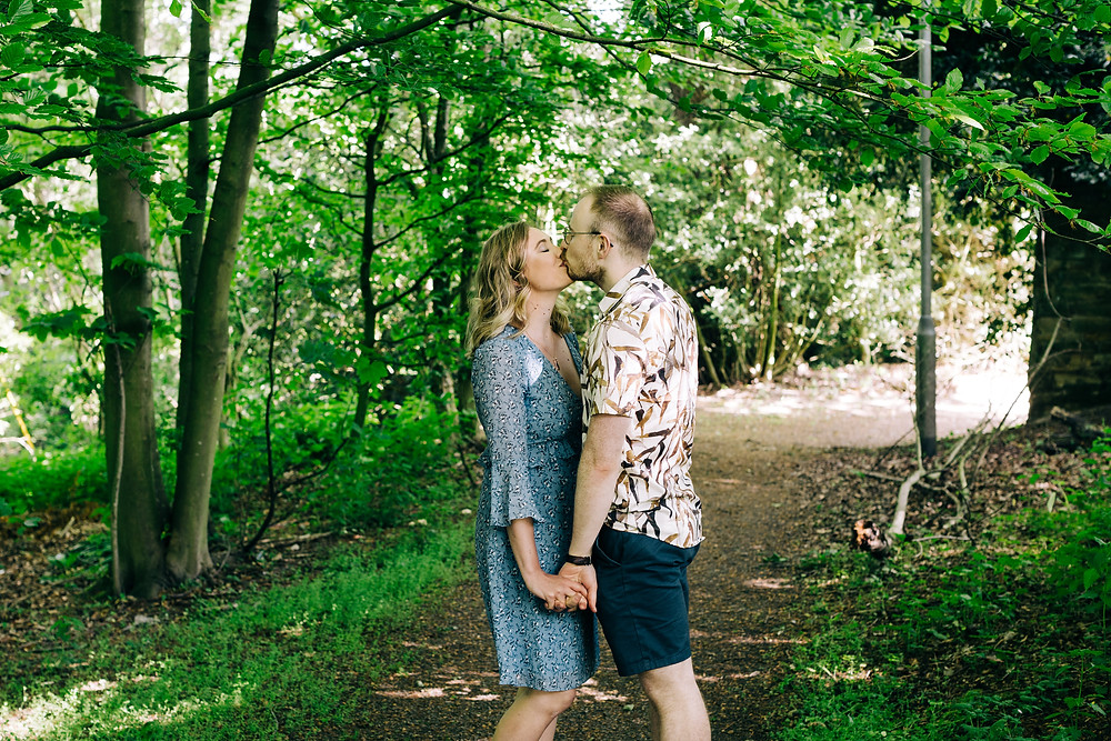 couple kissing in trees Durham engagement shoot casual university wedding