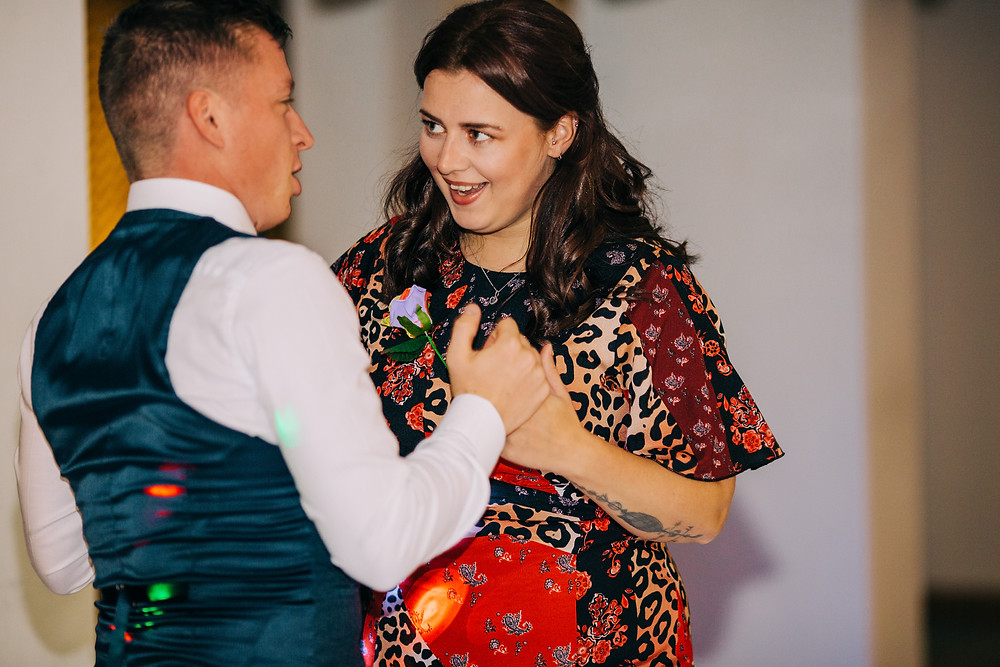 Colourful wedding photography showing guests dancing at reception Holiday Inn Newcastle
