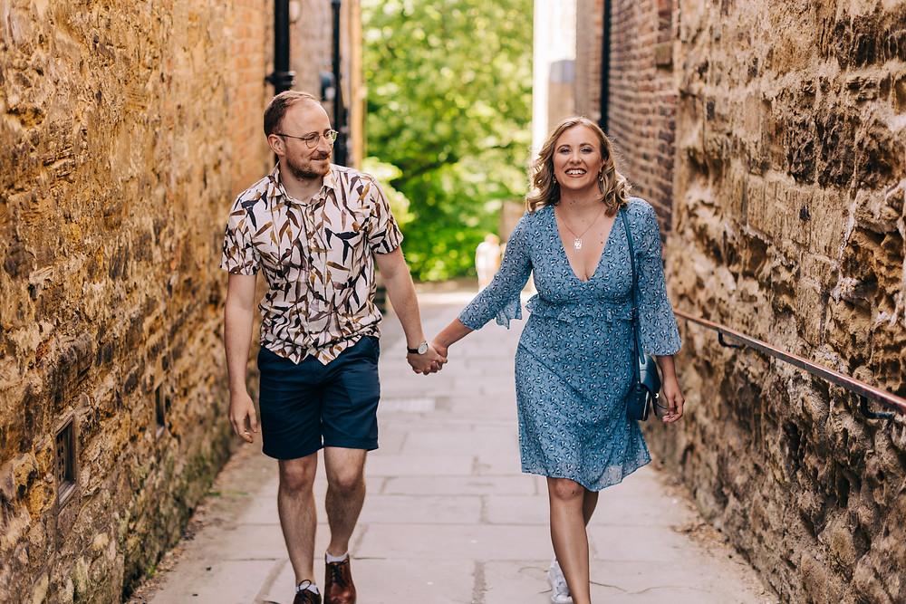 Durham city university engagement couples photo shoot walking hand hold